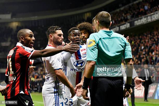 The referee Ruddy Buquet and Jordy Gaspar and Jordan Ferri of Lyon and Ricardo Pereira of Nice during the Ligue 1 match between OGC Nice and...