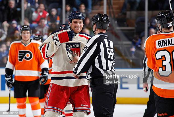 The referee separates Stu Bickel of the New York Rangers after a fight with an opponent on the Philadelphia Flyers at Madison Square Garden on...