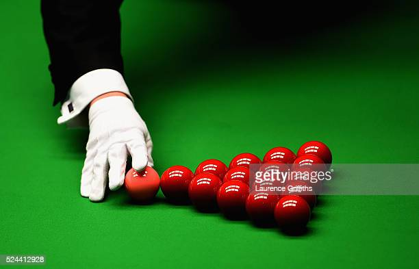 The Referee sets up the balls on day eleven of the World Championship Snooker at Crucible Theatre on April 26 2016 in Sheffield England