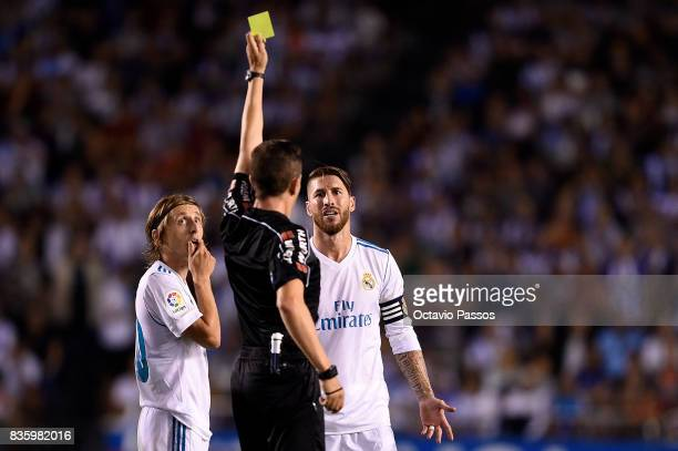 The referee show a yellow card to Sergio Ramos of Real Madrid during the La Liga match between Deportivo La Coruna and Real Madrid at Riazor Stadium...