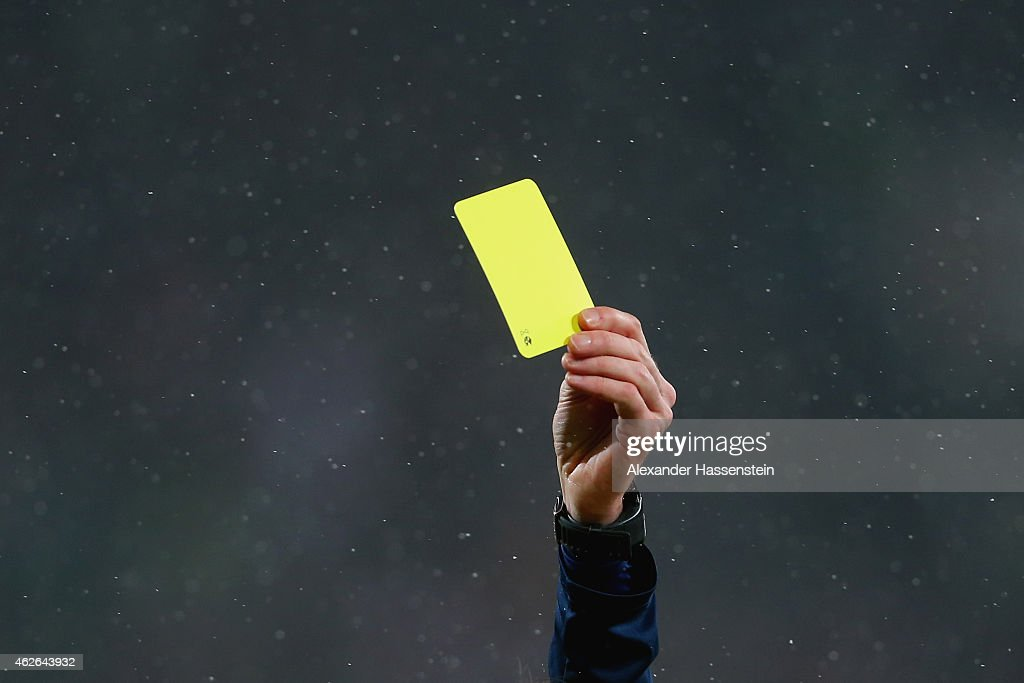 The referee show the Yellow card during the Bundesliga match between FC Augsburg and TSG 1899 Hoffenheim at SGL Arena on February 1 2015 in Augsburg...