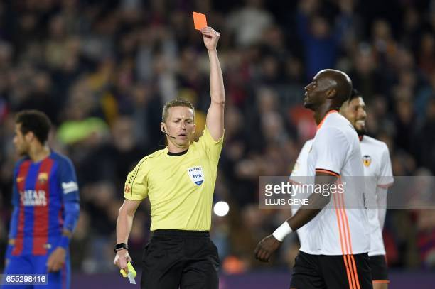 The referee shows a red card to Valencia's Brazilian defender Eleaquim Mangala during the Spanish league football match FC Barcelona vs Valencia CF...