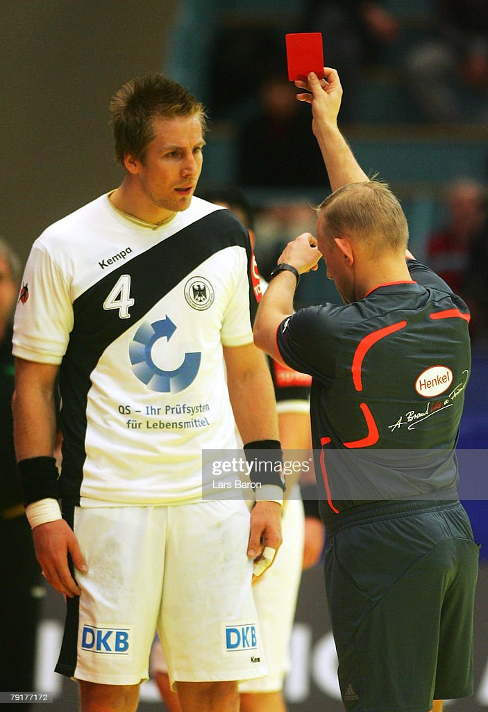 The Referee shows Oliver Roggisch of Germany the red card during the Men's Handball European Championship main round Group II match between Germany and France at Trondheim Spektrum on January 23, 2008 in Trondheim, Norway.