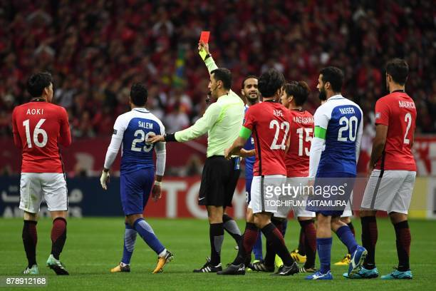 The referee shows the red card to Al Hilal's midfielder Salem alDawsari during the second leg of the AFC Champions League football final between...