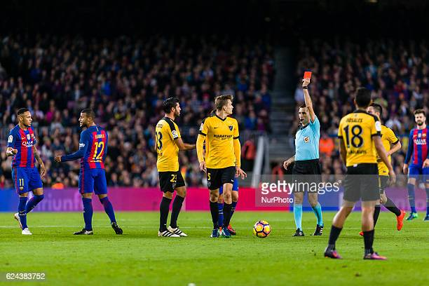The referee shows the red card to Diego Llorente during the match between FC Barcelona vs Malaga CF for the round 12 of the Liga Santander played at...