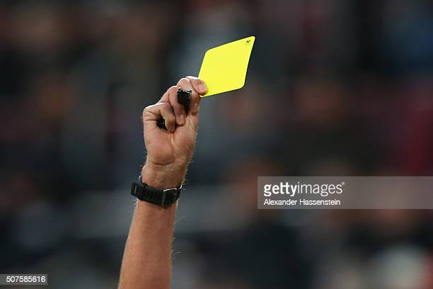 The referee shows the yellow card during the Bundesliga match between FC Augsburg and Eintracht Frankfurt at WWK Arena on January 30 2016 in Augsburg...