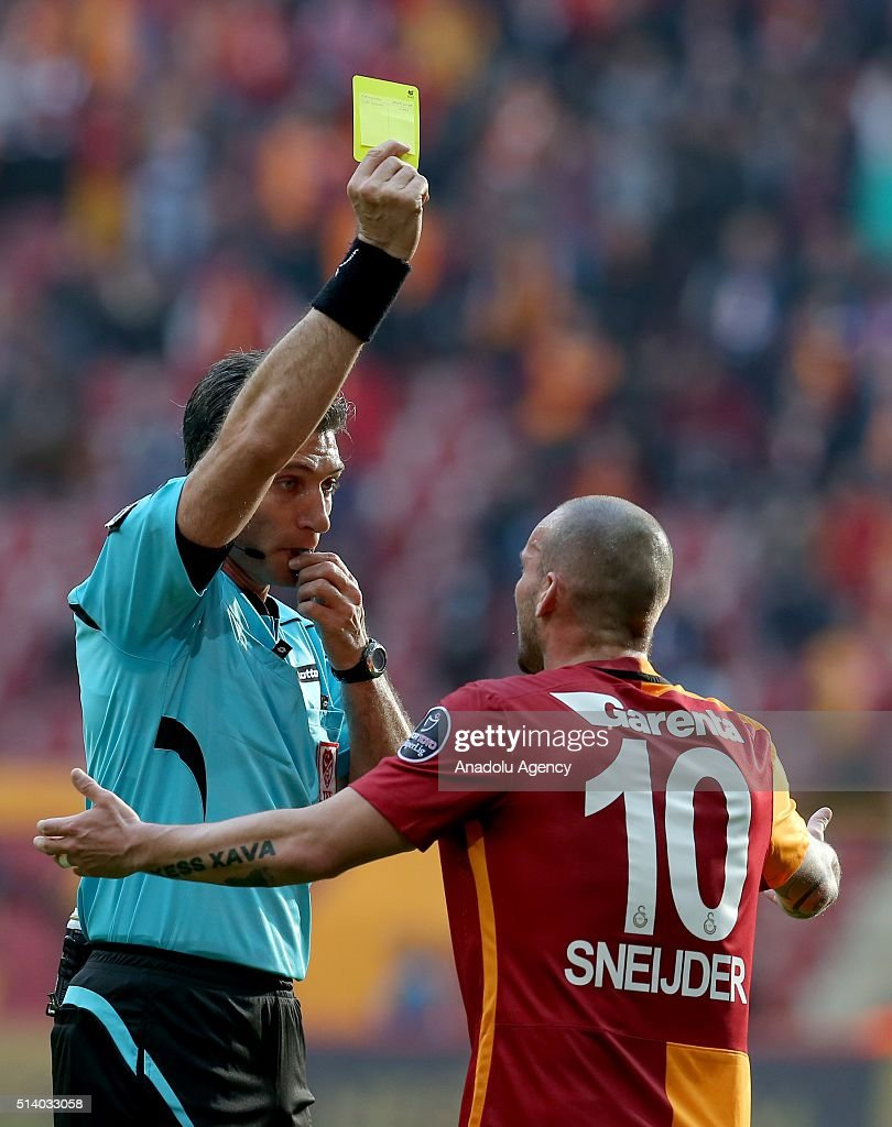 http://media.gettyimages.com/photos/the-referee-shows-yellow-card-to-wesley-sneijder-of-galatasaray-the-picture-id514033058