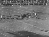 The referee signals 'Good' as O'Hearn of the Yale team drop kicks the football from the 20 yard line in its game against Harvard New Haven...