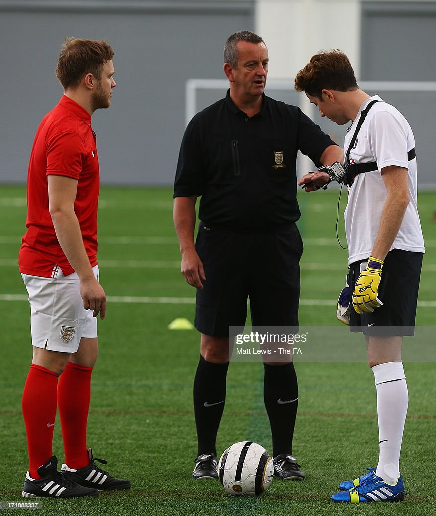 The referee speaks to Nick Grimshaw (R) and Olly Murs before the start of the BBC Radio 1 five-a-side football match between Team Grimshaw, captained by BBC Radio 1 DJ Nick Grimshaw and Team Murs, captained by singer and FA150 ambassador Olly Murs, at St Georges Park on July 29, 2013 in Burton-upon-Trent, England. In the build-up to Sir Bobby Robson National Football Day on August 10, the 5-a-side match was one of many events taking place around the country to mark The FA's 150th anniversary.