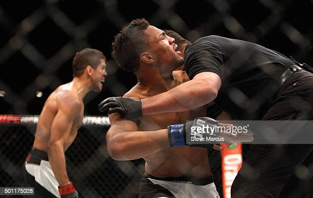 The referee stops a lightweight fight between Leonardo Santos and Kevin Lee during UFC 194 on December 12 2015 in Las Vegas Nevada
