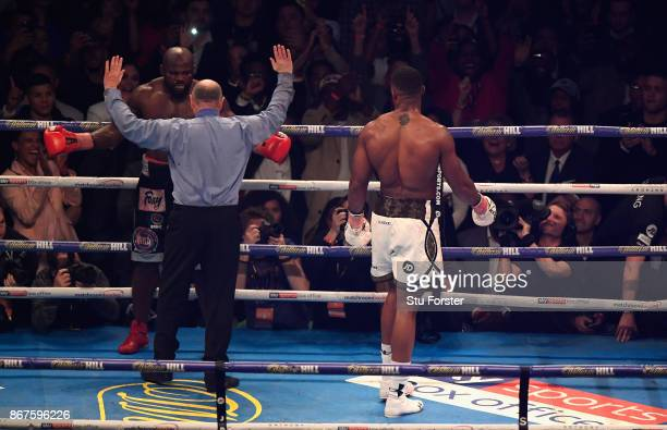 The referee stops the fight between Anthony Joshua and Carlos Takam World Heavyweight Title Fight at Principality Stadium on October 28 2017 in...