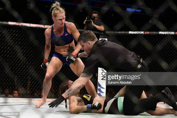 The referee stops the fight between Holly Holm of United States and Bethe Correia of Brazil in the WomenÕs Bantamweight Main Event Bout during UFC...