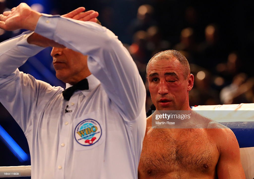 The referee stops the fight between Robert Stieglitz of Germany and Arthur Abraham during the WBO World Championship Super Middleweight title fight at Getec Arena on March 23, 2013 in Magdeburg, Germany.