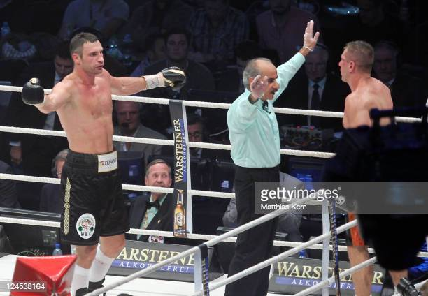 The referee stops the fight between Vitali Klitschko of the Ukraine and Tomasz Adamek of Poland during the WBC World Championship fight between...