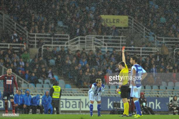 The referee Undiano Mallenco shows the red card to Juanmi of Real Sociedad during the Spanish league football match between Real Sociedad and Eibar...