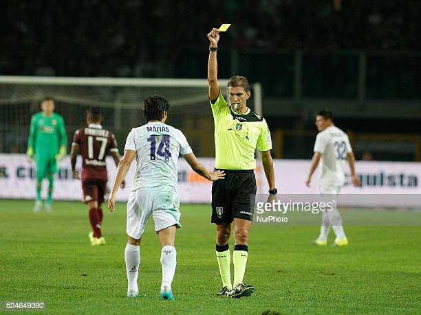 The referee warns Mati Fernandez during the serie A match between Torino FC and ACF Fiorentina at Olympic Stafium of Turin on august 3' 2015 in...