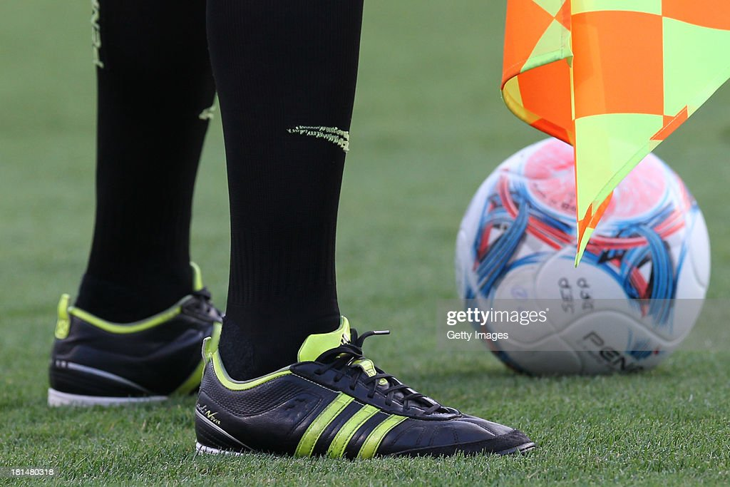 The referee wears ADIDAS shoes during the match between Palmeiras and Sport for the Brazilian Series B 2013 at Pacaembu stadium on September 21, 2013 in Sao Paulo, Brazil.