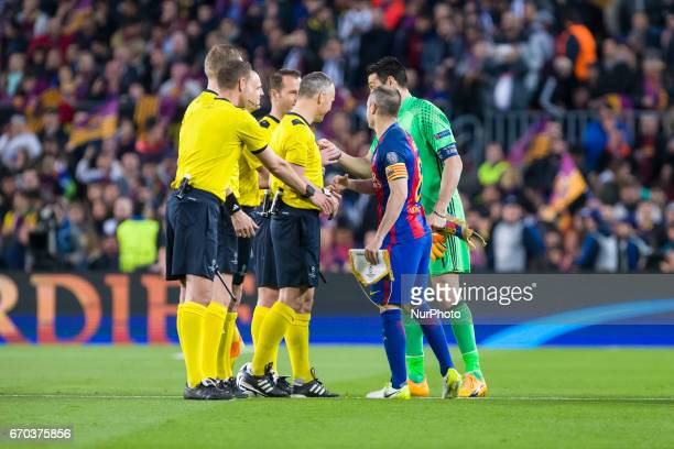 The referees Andres Iniesta of FC Barcelona and Gianluigi Buffon of Juventus FC during the UEFA Champions League Quarter Final second leg match...