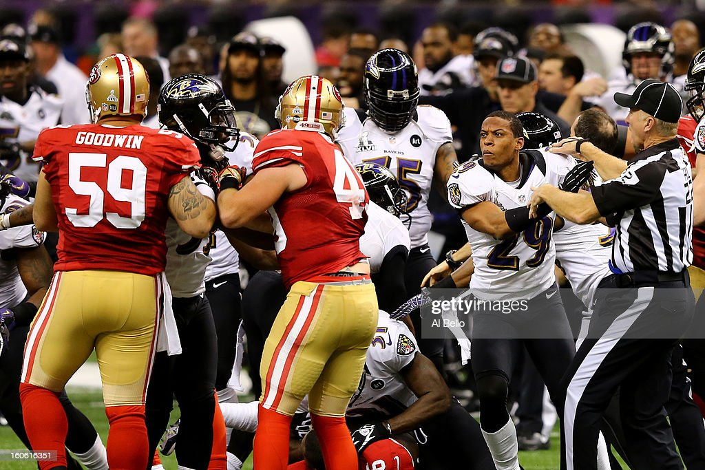 The referees attempt to break up a fight between Cary Williams #29 of the Baltimore Ravens and members of the San Francisco 49ers in the second quarter during Super Bowl XLVII at the Mercedes-Benz Superdome on February 3, 2013 in New Orleans, Louisiana.