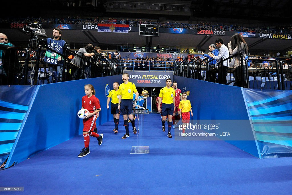 http://media.gettyimages.com/photos/the-referees-enter-the-pitch-during-the-serbia-v-slovenia-match-the-picture-id508115212