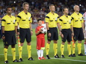 The referees pose before the UEFA Champions league football match FC Barcelona vs Ajax Amsterdam at Camp Nou stadium in Barcelona on September 18...