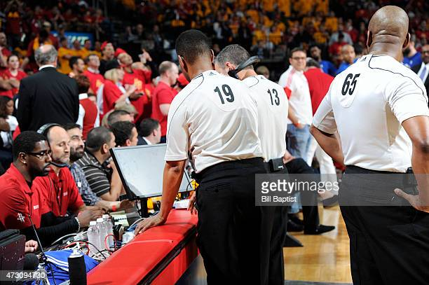 The referees review a replay at the replay center desk Game Five of the Western Conference Semifinals during the NBA Playoffs on May 12 2015 at...