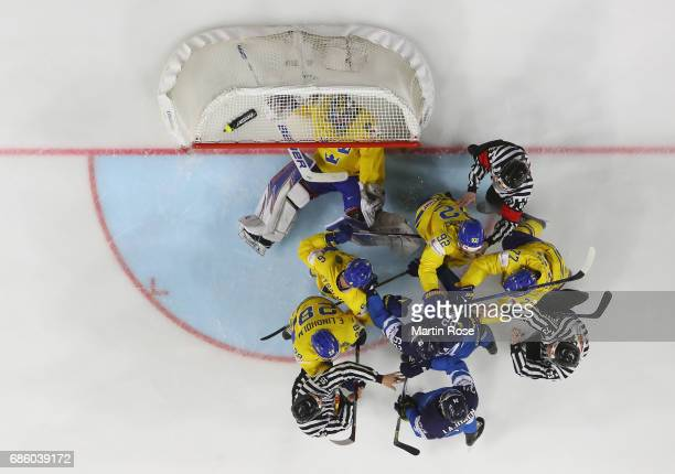 The referees try to break up a fight betwenn players of Sweden and of Finland during the 2017 IIHF Ice Hockey World Championship semi final game...
