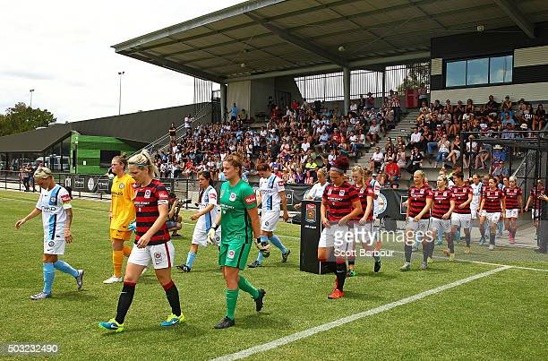 The referees Wanderers and City FC players walk onto the pitch during the round 12 WLeague match between Melbourne City FC and the Western Sydney...
