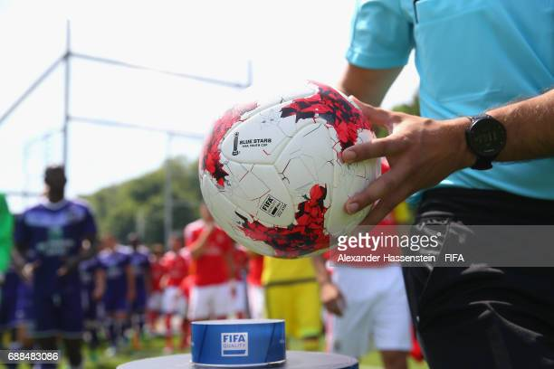 The referre takes the official matchball for day two of the Blue Stars/FIFA Youth Cup 2017 at the Buchlern sports complex on May 25 2017 in Zurich...
