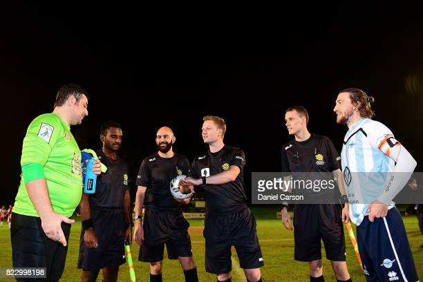 The referree tosses the coin with the two captains Angelo Konstantinou of Canberra Olympic FC and Daryl Platten of Sorrento FC during the FFA Cup...