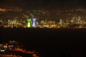 The refineries chimneys lighted at night on March 04 2007 in Haifa Israel Israel Corp ltd is a holding company owned by the Israeli Ofer family the...
