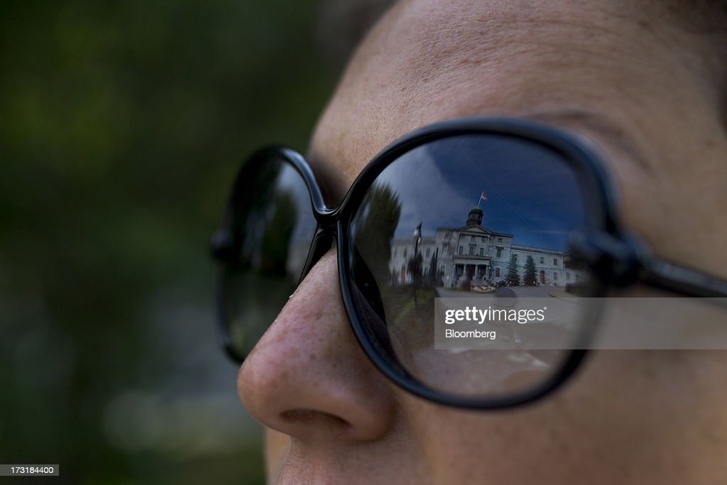 The reflection of a building at the McGill University campus is seen in a woman's sunglasses in Montreal, Quebec, Canada, on Monday, July 8, 2013. Montreals city council elected Laurent Blanchard as interim mayor to replace Michael Applebaum, who quit last week after being arrested on corruption charges. Photographer: Brent Lewin/Bloomberg via Getty Images