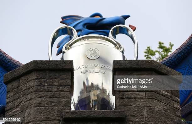 The reflection of Cardiff city can be seen in the UEFA Champions League trophy next to the dragon at Cardiff Castle prior to the UEFA Champions...