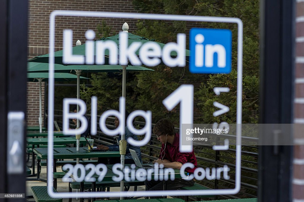 The reflection of employees are seen in a door at LinkedIn Corp. headquarters in Mountain View, California, U.S., on Monday, July 28, 2014. LinkedIn Corp. is scheduled to release earnings figures on July 31. Photographer: David Paul Morris/Bloomberg via Getty Images