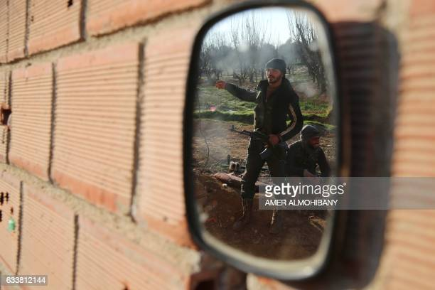 TOPSHOT The reflection of fighters from the Jaish alIslam the foremost rebel group in Damascus province who fiercely oppose both the Syrian regime...