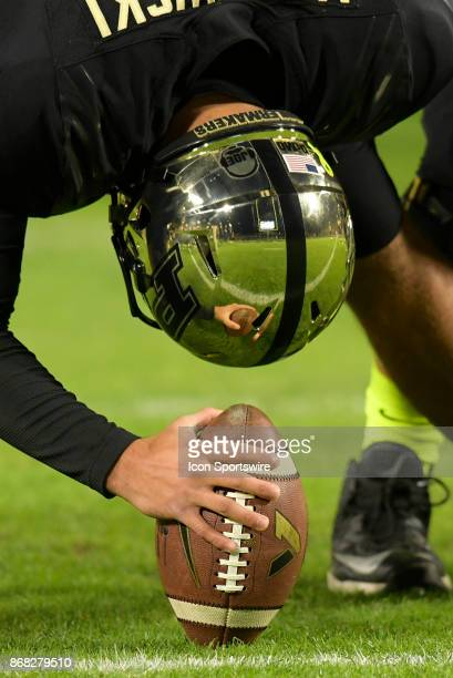 The reflection of the goalpost is seen in the helmet of Purdue Boilermakers long snapper Ben Makowski during the Big Ten conference game between the...
