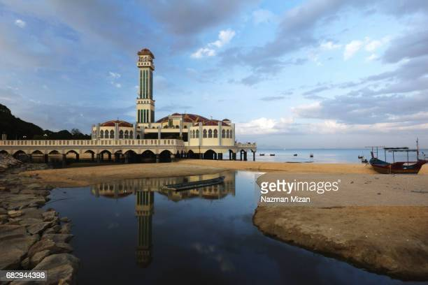 The reflection of The Penang Floating Mosque.