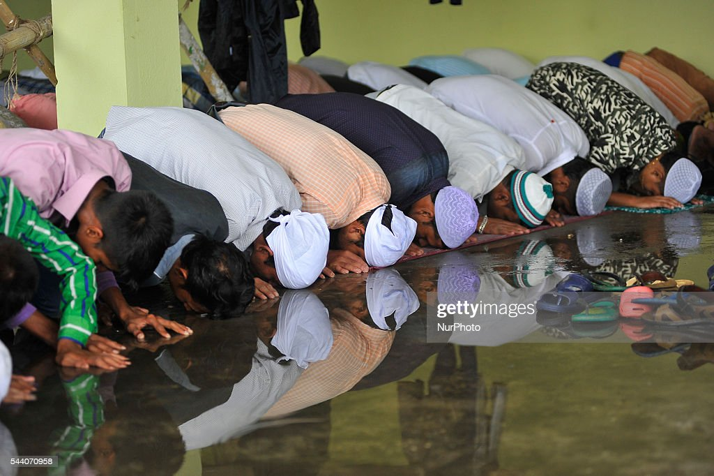 The Reflection seen on water as Nepalese Muslim offering Ritual Prayer on Last Friday of Ramadan on a monsoon rain at Kashmari Jame mosque at Kathmandu on July 1, 2016. Ramadan (also known as Ramadhan or Ramzan) is the ninth month in the Islamic calendar. During the month of Ramadan; Muslims fast from dawn to dusk all over the world. While fasting from dawn until sunset; Muslims avoid from consuming food; drinking liquids; smoking; and engaging in sexual relations.