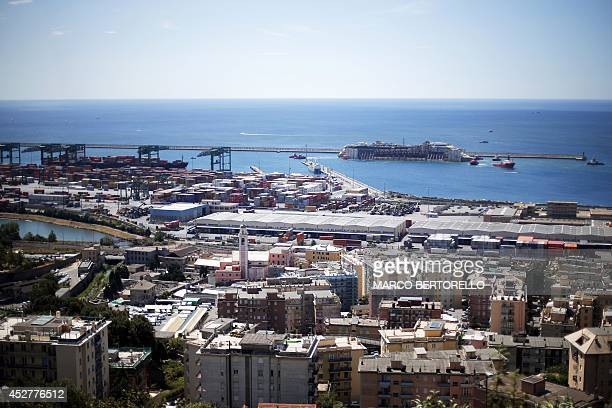 The refloated wreck of the Costa Concordia cruise liner is towed to the Italian port of Genoa on July 27 2014 The wreck of the Costa Concordia...
