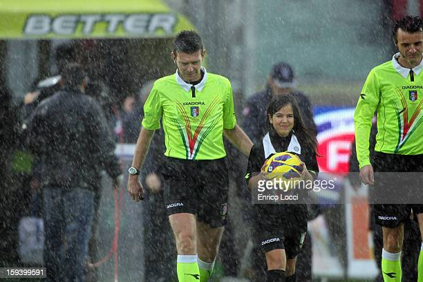 The refree Rocchi walks onto the pitch during the Serie A match between Cagliari Calcio and Genoa CFC at Stadio Sant'Elia on January 13 2013 in...