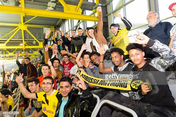 The refugees which Borussia Dortmund invited to watch the match prior to the UEFA Europa League Third Qualifying Round 1st Leg match between Borussia...