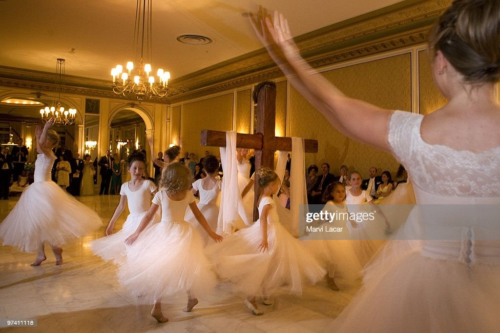 The Regal Daughters Ballet Company dance around the wooden cross in the ballroom of the Broadmoor Hotel on May 16, 2008 in Colorado Springs, Colorado. The annual Father-Daughter Purity Ball, founded in 1998 by Randy and Lisa Wilson, focuses on the idea that a trustworthy and nurturing father will influence his daughter to lead a lifestyle of 'integrity and purity.'