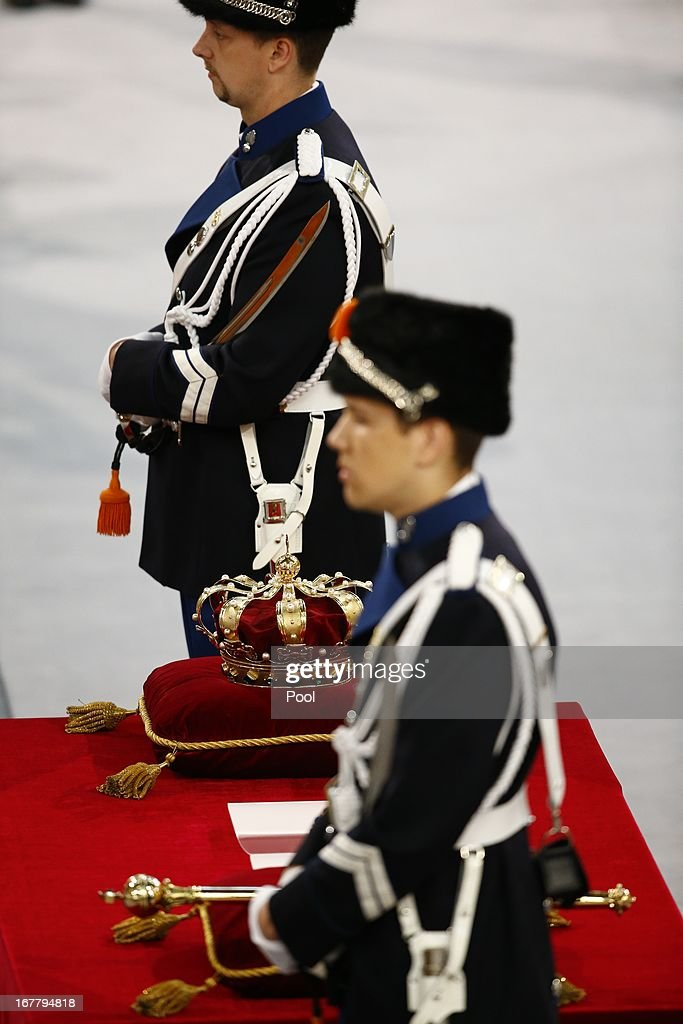 The regalia (Crown, Sceptre, Globus Cruciger and Sword of State) are displayed next to guards before the inauguration of HM King Willem Alexander of the Netherlands and HRH Queen Maxima of the Netherlands at New Church on April 30, 2013 in Amsterdam, Netherlands.
