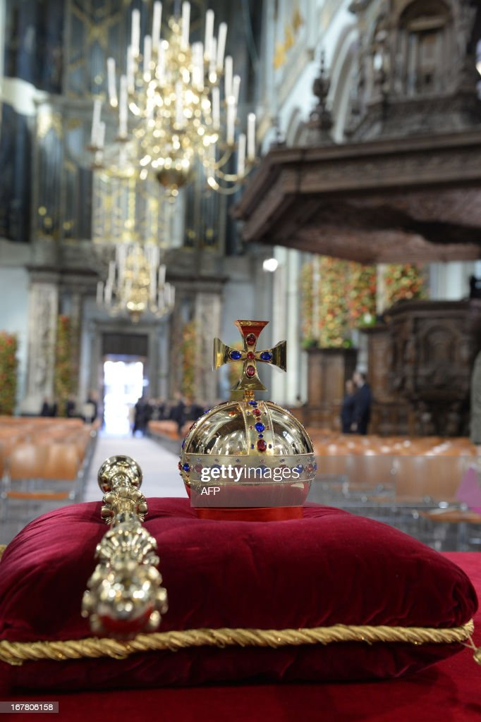 The regalia (Crown, Sceptre, Globus Cruciger and Sword of State) lay on the credence-table ahead of the investiture ceremony for King Willem-Alexander of the Netherlands at the Nieuwe Kerk (New Church) in Amsterdam on April 30, 2013.