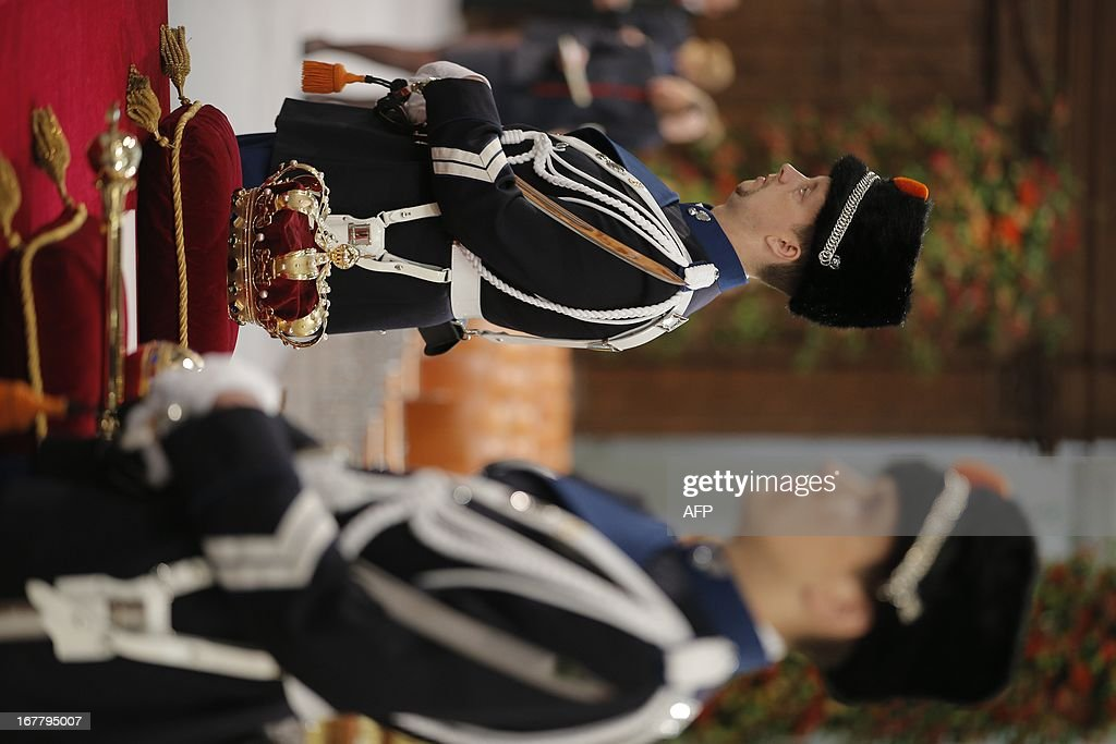 The regalia (Crown, Sceptre, Globus Cruciger and Sword of State) lie at the credence-table at the start of the inauguration of King Willem-Alexander at Nieuwe Kerk or New Church in Amsterdam on April 30, 2013. DEJONG