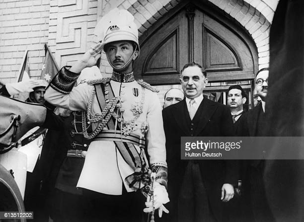 The Regent of Iraq with the Prime Minister General Nuri asSaid on his left receives the salute of the Guard of Honour at the opening of the Iraq...