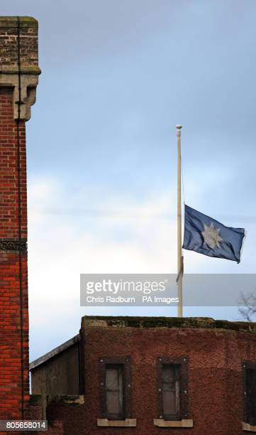 The Regimental Flag of The Royal Anglian Regiment flies at half mast above the Regimental Headquarters in Bury St Edmunds Suffolk