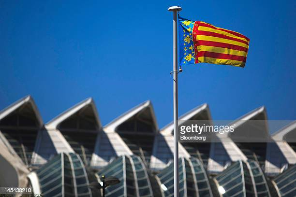The regional flag of Valencia flies outside the Prince Felipe Science Museum at the City of Arts and Sciences in Valencia Spain on Tuesday May 29...