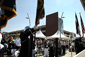 The Regional Transportation District color guard posts the colors as the ceremony to open its second major commuter train station the B Line in...