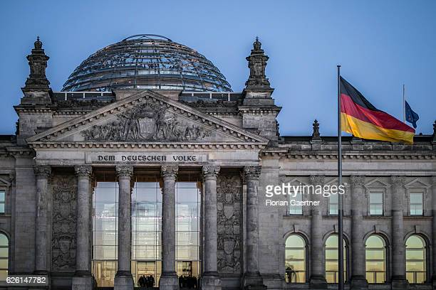 The Reichstag building is pictured at blue hour on November 27 2016 in Berlin Germany